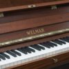 The keyboard of the Welmar satin mahogany