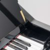 The end of the keyboard of the Yamaha U1 Silent in Polished Black
