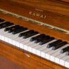 walnut finished kawai K2 upright piano keyboard