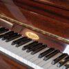 polished mahogany kemble upright piano keyboard