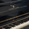 polished black steinway model z upright piano with grand piano style lid keyboard