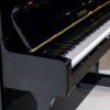 polished black yamaha u1 upright piano close up
