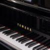 polished black Yamaha GB1 baby grand piano keyboard