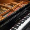 polished black Yamaha GB1 baby grand piano interior