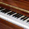 polished mahogany zimmerman upright piano keyboard