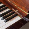 polished mahogany zimmerman upright piano detail